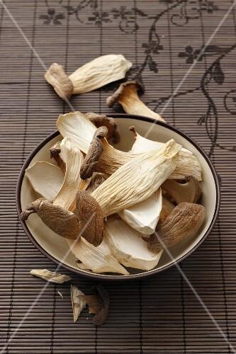 A bowl of dried king trumpet mushrooms