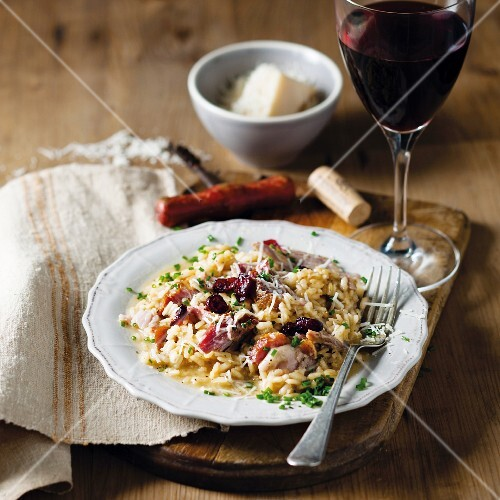 Cranberry risotto with smoked pork knuckle