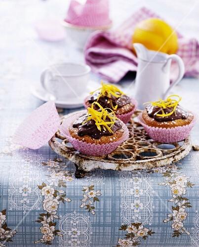 Cupcakes with chocolate cream and orange zest