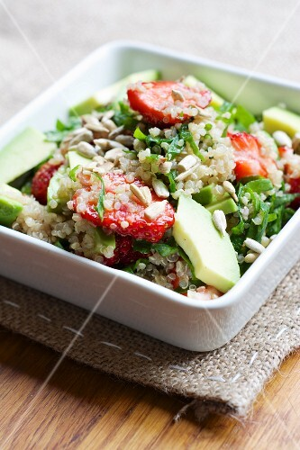 Quinoa and strawberry salad with spinach and avocado