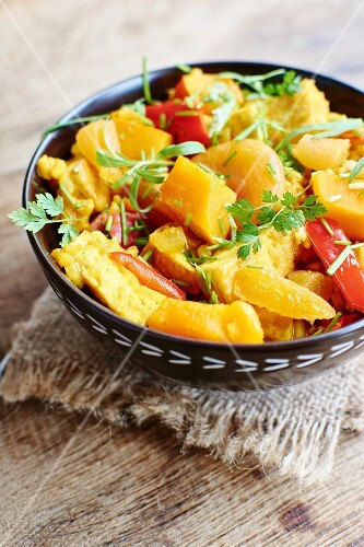 Pumpkin risotto with tofu, apricots, peppers and herbs