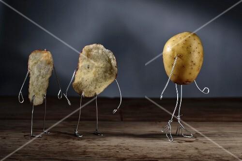 Potato crisp men watching a potato girl