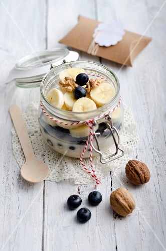 Breakfast with porridge, banana and blueberries