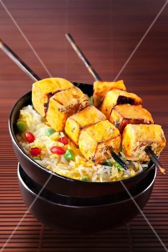 Grilled paneer skewers on a bed of rice