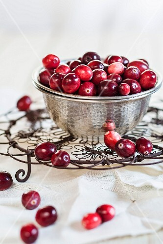 Cranberries in a metal bowl on a cooling rack