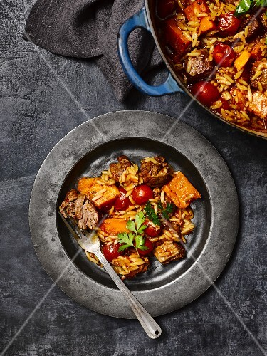 Lamb and pumpkin stew with rice pasta