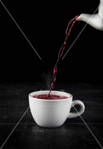 Raspberry tea being poured