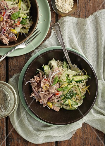 Couscous salad with tuna fish, courgette and onions