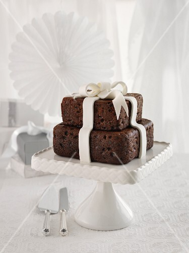 A chocolate wedding cake with a fondant bow