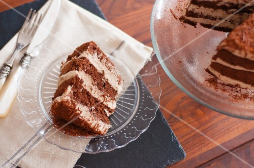 Mocha cake with grated chocolate on a glass plate
