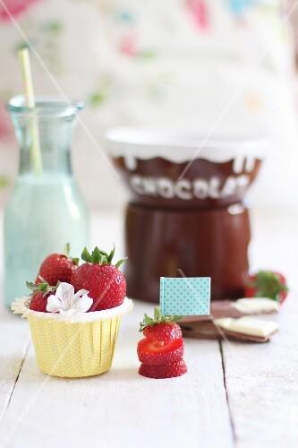 Fresh strawberries and chocolate sauce (ingredients for chocolate fondue)