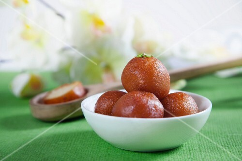 Gulab jamun in a bowl (deep-fried dough balls in syrup, India)