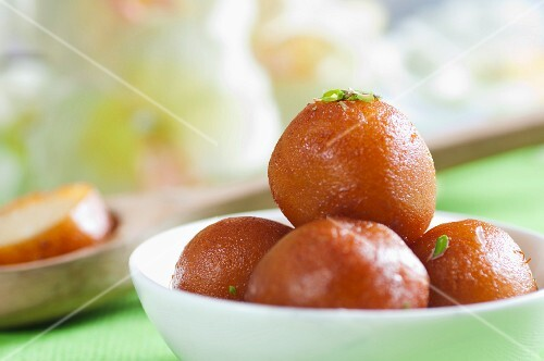 Gulab jamun (deep-fried dough balls in syrup, India)