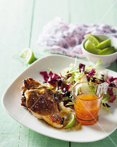 Pork chops with a marmalade and chilli glaze and an apple and cabbage salad