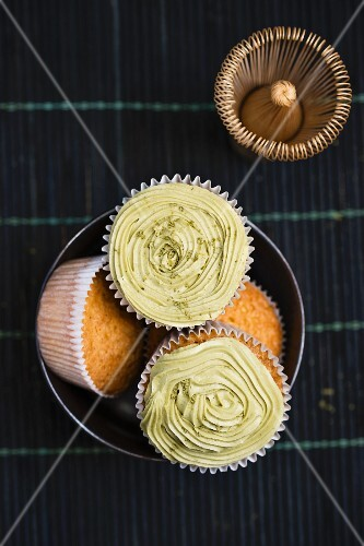 Matcha tea cupcakes with a tea whisk