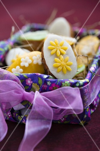 Mini marzipan pancakes in an Easter basket (close-up)