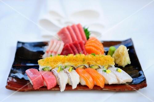 A mixed sushi platter with nigiri, maki and sashimi