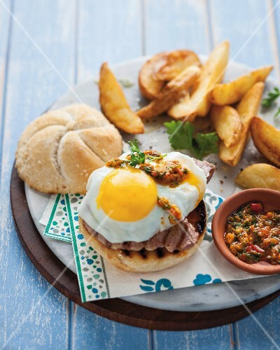 Steak sandwich with fried egg and chimichurri