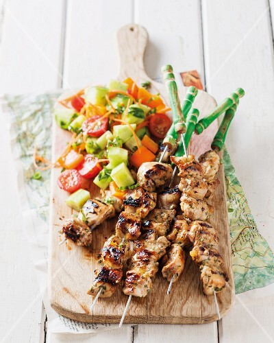 Chicken skewers with a tomato and cucumber salad