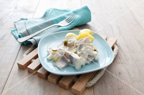 Heringsstipp (marinated, preserved herring dish) with boiled potatoes