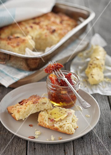 Bacon and cheddar scones with butter and dried tomatoes