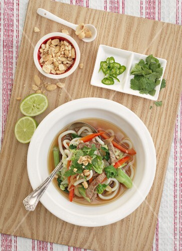 Soup with beef, ginger, noodles, peanuts and coriander (Asia)