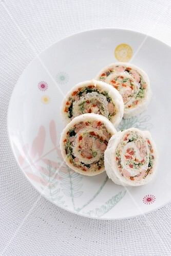 White bread rolls with anchovies, herbs and peppers