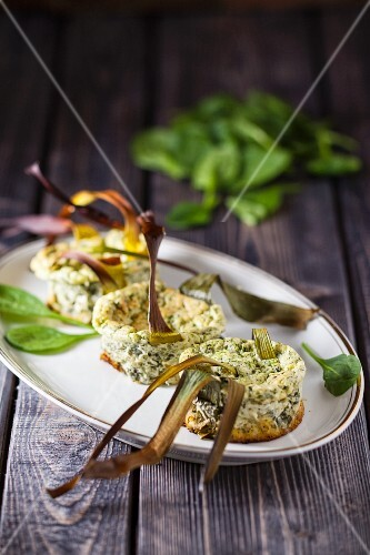 Mini spinach soufflé is on a serving platter