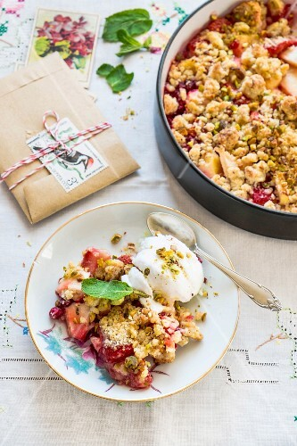 Apple and strawberry crumble on a plate and in a baking tin