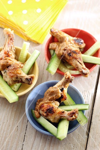 Grilled chicken wings on cucumber sticks