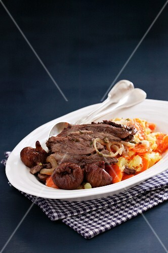 Beef steak with mushrooms and carrots
