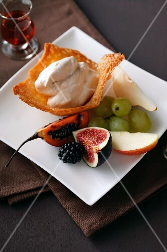 Cinnamon cream in a wafer bowl with fresh fruit