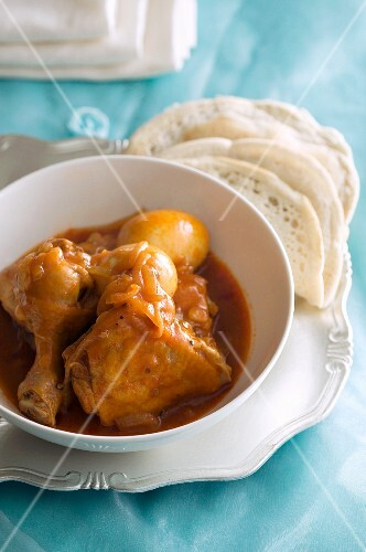 Doro wot (Ethiopian chicken dish) with injera (unleavened bread)