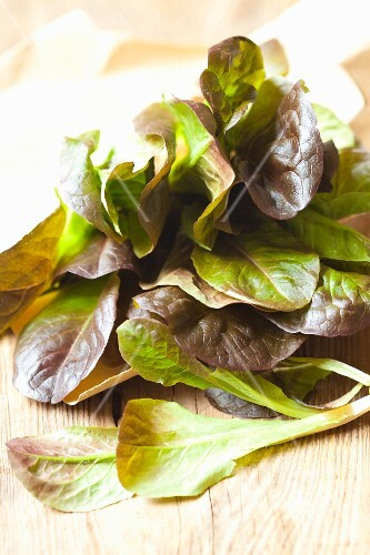 Red organic lamb's lettuce on a wooden surface