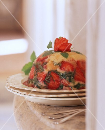 Orange and strawberry pudding with mint