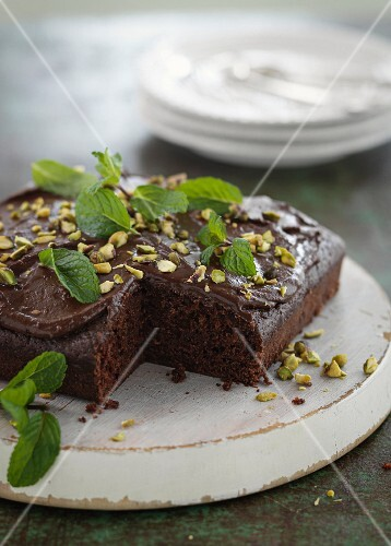 Chocolate and courgette cake with pistachios and fresh mint
