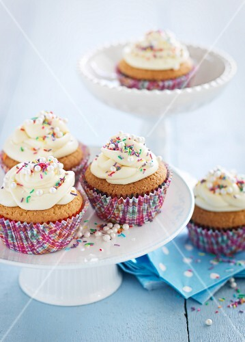 Cupcakes decorated with butter cream and sugar pearls