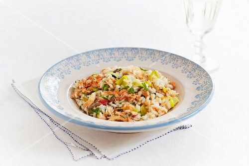 Seafood risotto with crab, parsley, spring onions and peppers