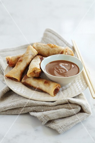 Deep fried spring rolls with a peanut dip (Asia)