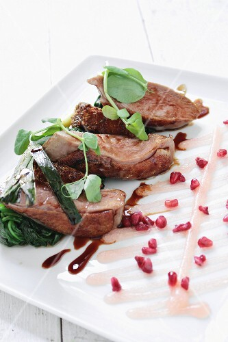 Pan-fried duck breast with polenta and spinach