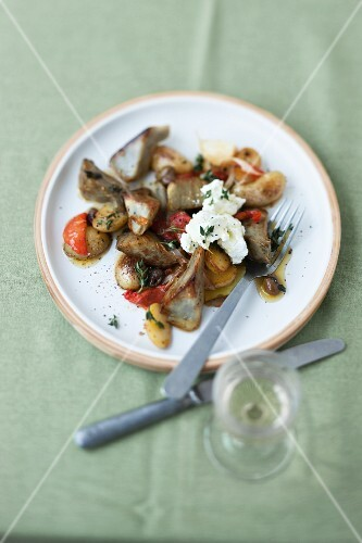 Fried artichoke hearts and potatoes with feta cheese