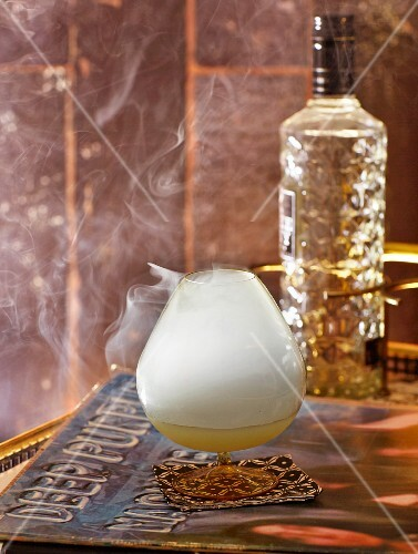 Smoke on the Water cocktail with Absinth and liqueur