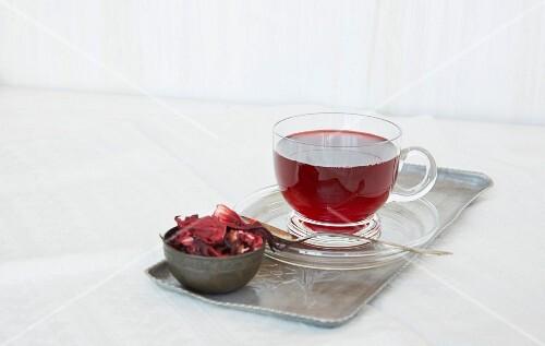 Fruit tea in a glass teacup