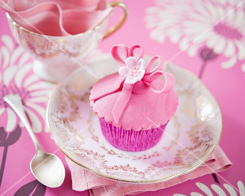 Pink flower cupcakes on a gilded plate