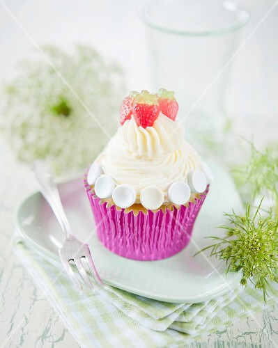 A summery cupcake with vanilla cream and strawberry jelly sweets