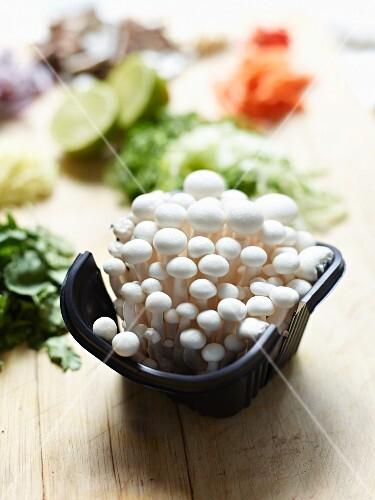 Fresh shimeij mushrooms in a plastic bowl