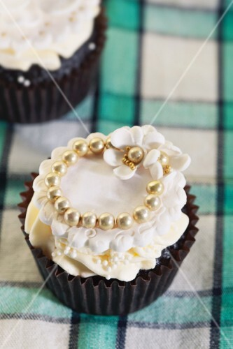 A festive cupcake decorated with pearls