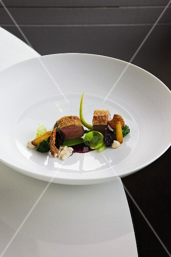 Saddle of venison with winter vegetables, walnuts and red cabbage juice
