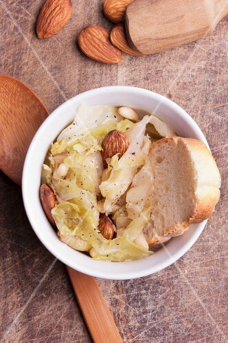Cabbage soup with almonds, pine nuts and a slice of white bread