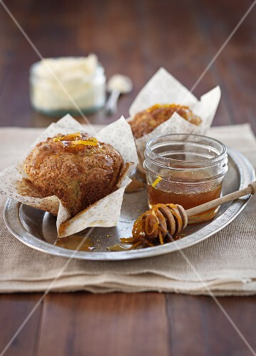 Orange and poppy seed muffins with honey